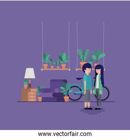 couple in the living room with houseplants and bicycle