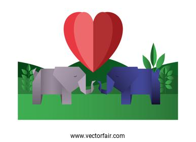 elephants couple origami paper with heart in the field