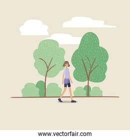 young woman walking on the park