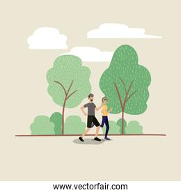 young couple running on the park