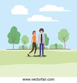 young couple walking on the park