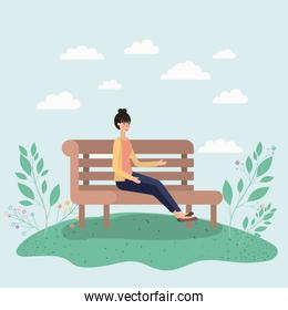 beautiful woman sitting on park chair