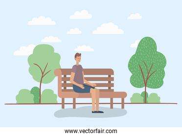 young man sitting on park chair