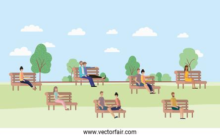 young people sitting on park chair