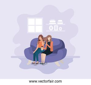 couple of women in living room using technology