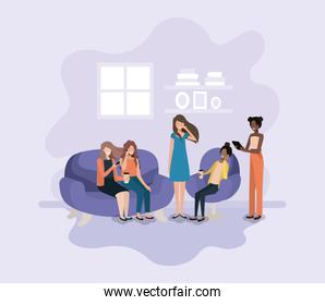 group of women in living room using technology