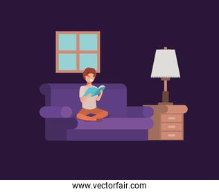 young student sitting reading book in livingroom