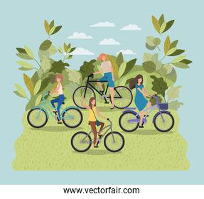 group of young women in bicycle on park