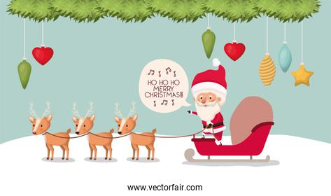 santa claus with carriage and deer in snowscape
