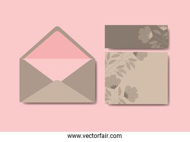 envelope with invitation and floral decoration