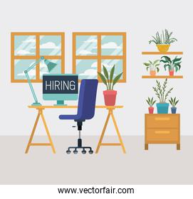 office workplace with we are hiring message
