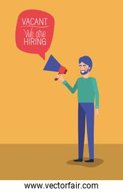 man using megaphone with we are hiring message