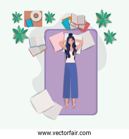 young woman relaxing in mattress in the bedroom