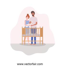parents taking care of newborn baby with cradle