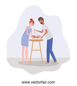 parents taking care of newborn baby with diaper changer icon