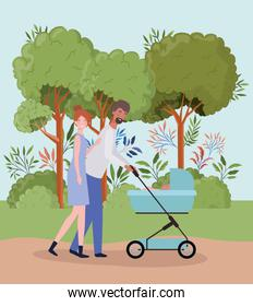 parents taking care of newborn baby with cart in the park