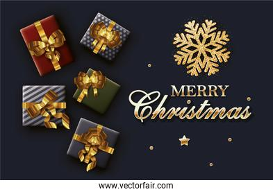 merry christmas calligraphy card with gift and golden ribbon