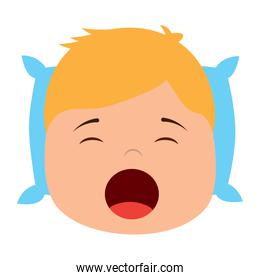 young boy with head in pillow yawning