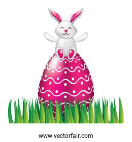 cute bunny sitting in easter egg on grass