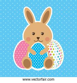 cute brown rabbit sitting with decorative eggs