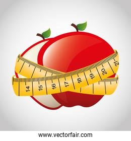 apple fruit with tape measure