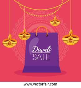 diwali sale card with shopping bag and candles hanging