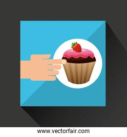hand with delicious cupcake strawberry chocolate