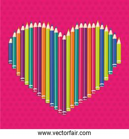 colored pencils forming a heart on pink dots