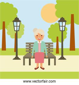 cute grandmother sitting in bench resting happy