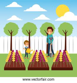 mother and son watering flowers in plowing field