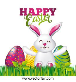 happy easter card white rabbit sitting with colorful eggs in grass