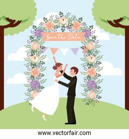 celebrating couple wedding in park arch flowers save the date card