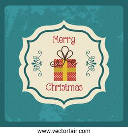 merry christmas lettering and giftbox over blue