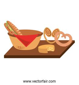 wicker basket with sandwich and pretzel cheese on wooden