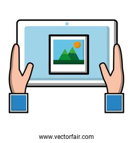 hand holding tablet computer with photo on screen