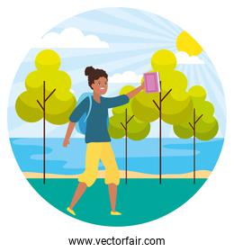 woman with bag and book landscape nature trees river