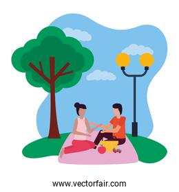 couple eating picnic romantic in the park