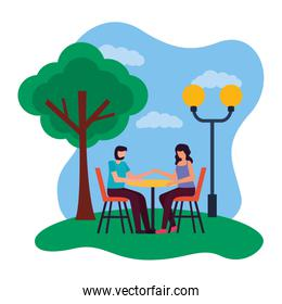 couple eat in the table romantic park
