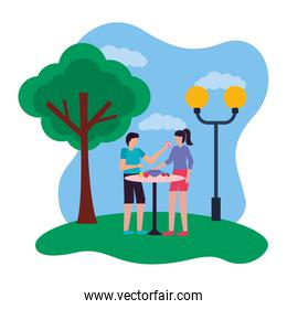 couple eating fruits romantic in the park