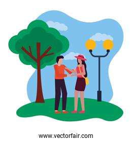 romantic couple in the park with lamp post and tree