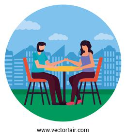 couple eat in the table romantic city park