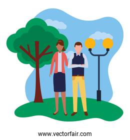 business man and woman in the park