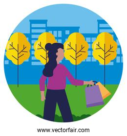 woman with shopping bags in the city park