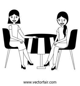 young women sitting at the table in chairs