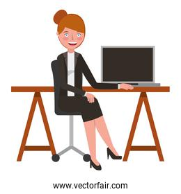 young woman sitting at the desk with laptop