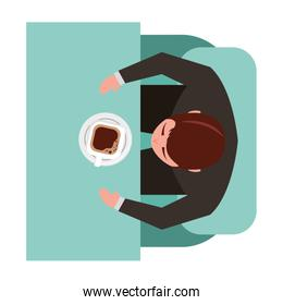 aerial view of man sitting in sofa with desk and cup coffee