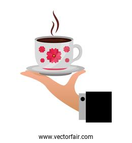 hand holding decorative flower hot coffee cup on dish