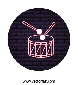 neon instrument musical drum and sticks on brick wall