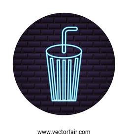neon disposable cup soda and straw on brick wall