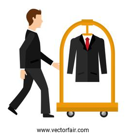 man with hotel luggage trolley and suit